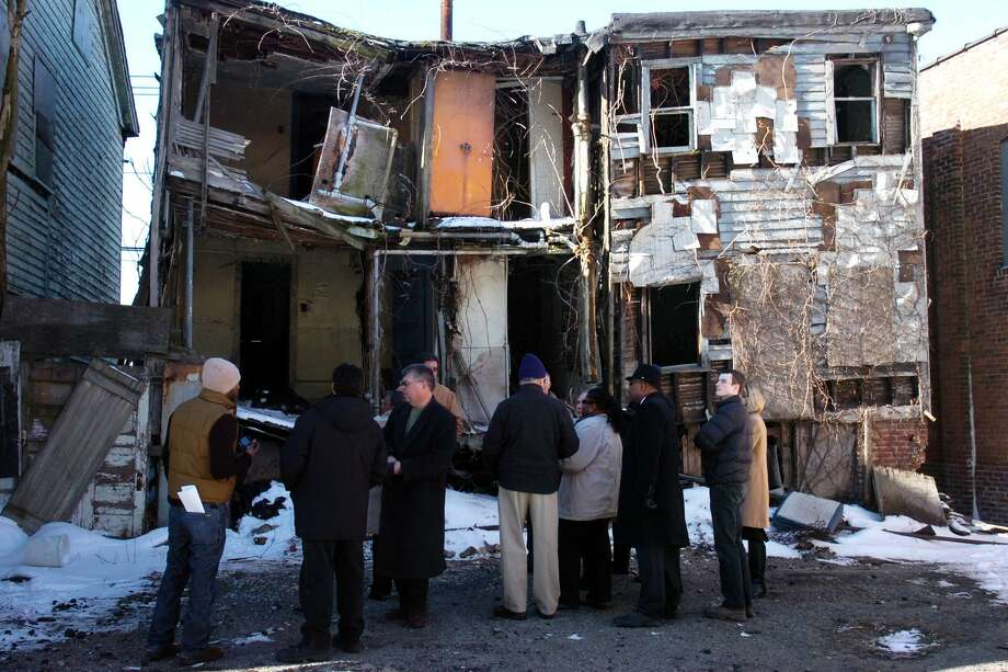 """A tour of the Little Liberia houses in Bridgeport, Conn. Feb. 12th, 2010. On Friday, May 19, 2017, Keith W. Stokes, vice president of the 1696 Heritage Group, and a descendant of Bridgeport's pre-Civil War era African-American community, Little Liberia, will discuss """"Legacies of Slavery & Freedom: A Family Journey through the Atlantic World,"""" at 6 p.m. in the Burt Chernow Galleries at Housatonic Community College. Photo: Ned Gerard / ST / Connecticut Post"""