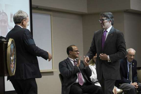 Lt. Gen. Leroy Sisco presents Secretary of the Department of Energy and former governor Texas Rick Perry to the audience at the VA Research Week 2017, Monday, May 15, 2017, in Houston. ( Marie D. De Jesus / Houston Chronicle )