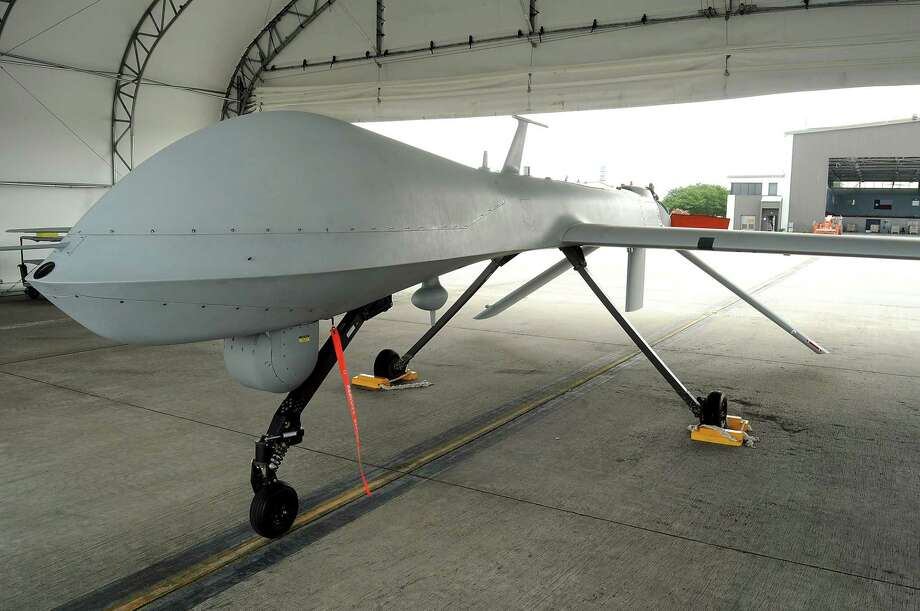 A Predator drone of the 147th Reconnaissance Wing at Ellington Field sits in a hangar Thursday June 10,2010. (Dave Rossman Photo) Photo: Dave Rossman, Freelance / For The Chronicle / Freelance