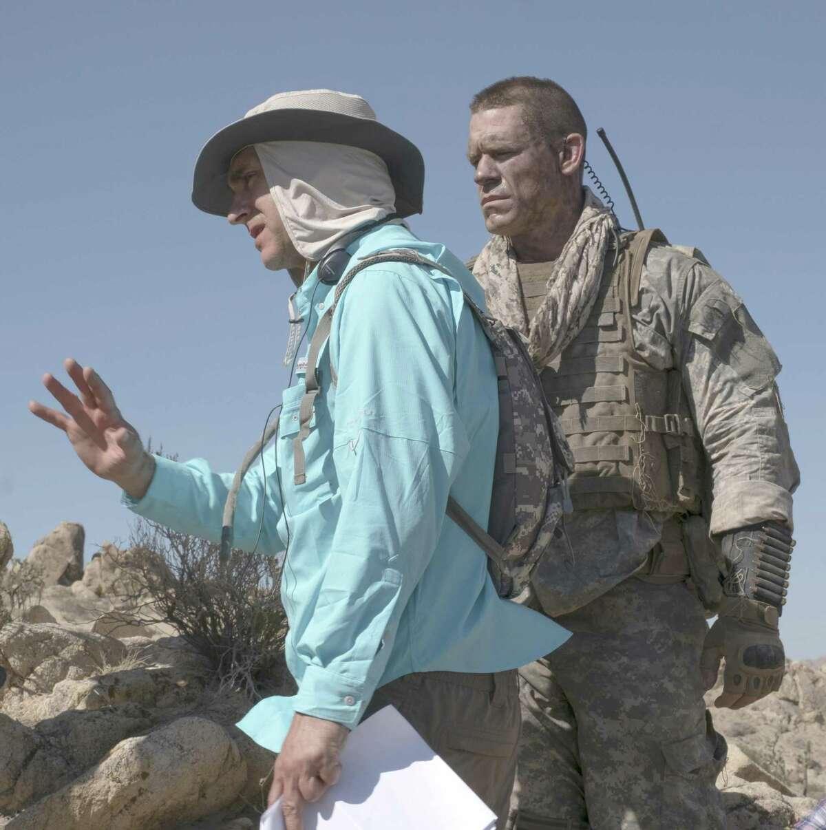 Director Doug Liman and John Cena in