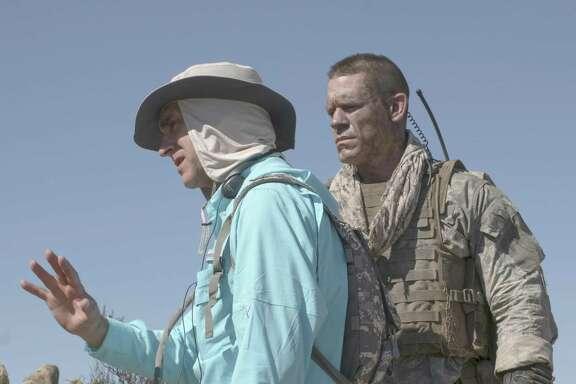 "Director Doug Liman and John Cena in ""The Wall."" MUST CREDIT: David James, Roadside Attractions"