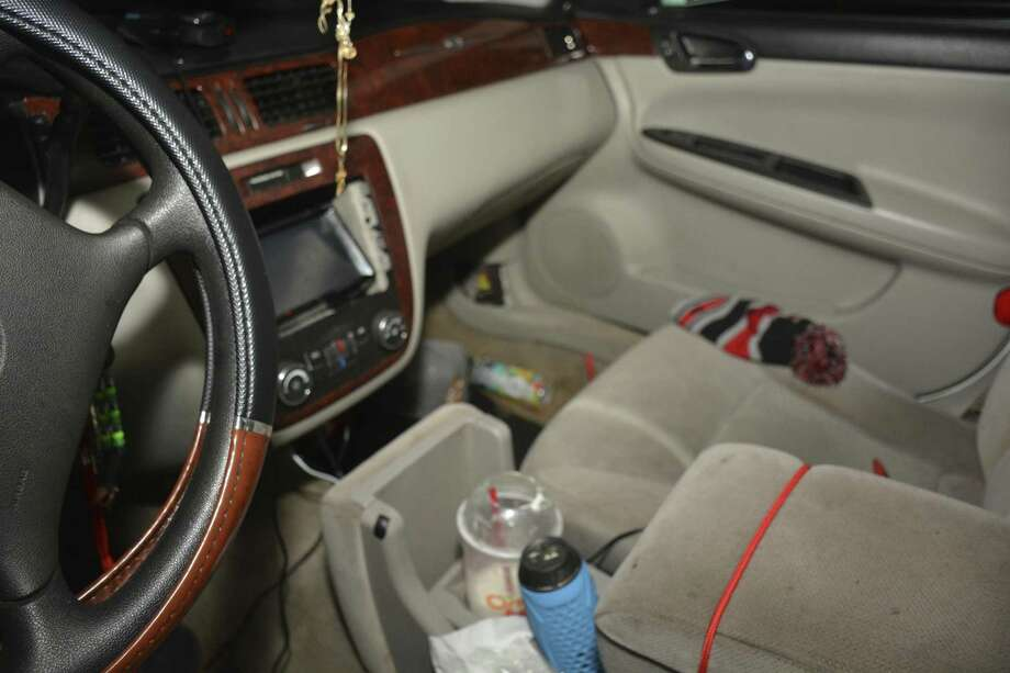 The inside of Calin Devonte Roquemore's white Chevrolet Impala, which an officer tried to pull over one night in Beckville. Roquemore refused to stop, leading the officer on a short vehicle and then foot chase. Roquemore was shot after falling while running. Source: Panola County. Photo: Panola County
