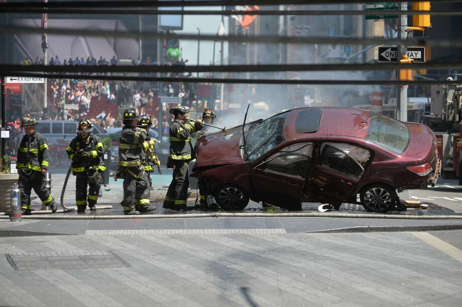The aftermath of a car being driven into pedestrians in Times Square in New York, May 18, 2017. Photo: Erik Pendzich/REX/Shutterstock/AP