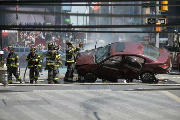 The aftermath of a car being driven into pedestrians in Times Square in New York, May 18, 2017.