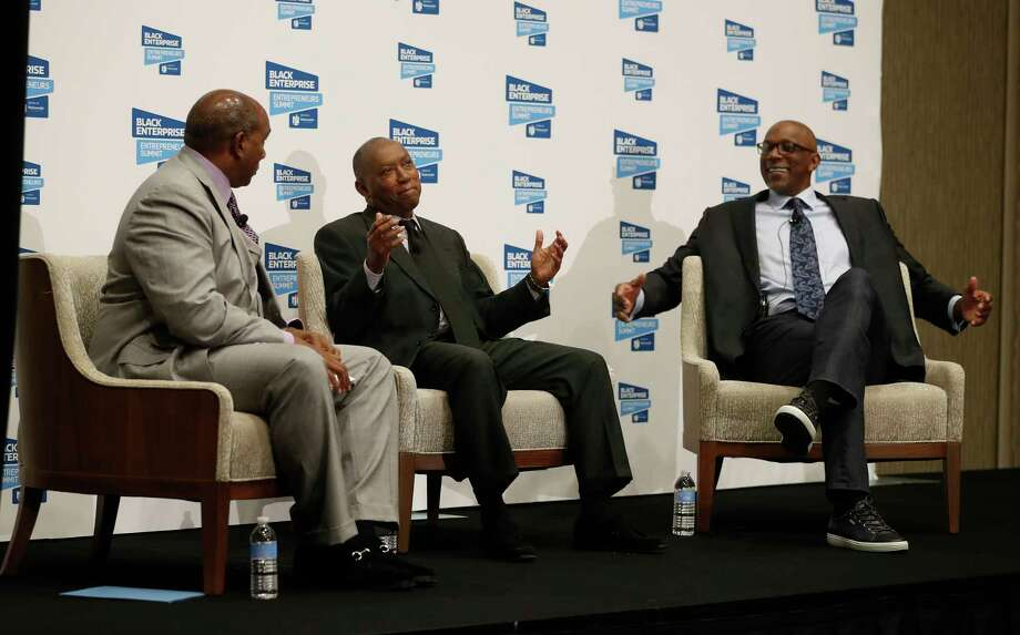 "Black Enterprise President and CEO Earl ""Butch"" Graves, Jr., left,  Mayor Sylvester Turner center, and NBA Hall of Famer Clyde Drexler speak on stage as Houston hosted the 22nd annual Black Enterprise Entrepreneur Summit bringing together thousands of African American entrepreneurs from across the nation for three days at the Marriott Marquis Houston,  Wednesday,  May 17, 2017. ( Karen Warren / Houston Chronicle ) Photo: Karen Warren, Staff Photographer / 2017 Houston Chronicle"