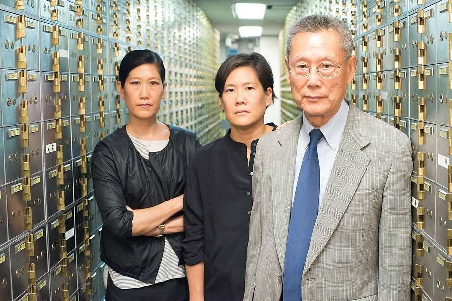 "Vera Sung (left), Jill Sung and Thomas Sung, in the documentary ""Abacus: Small Enough to Jail."" Photo: Sean Lyness"