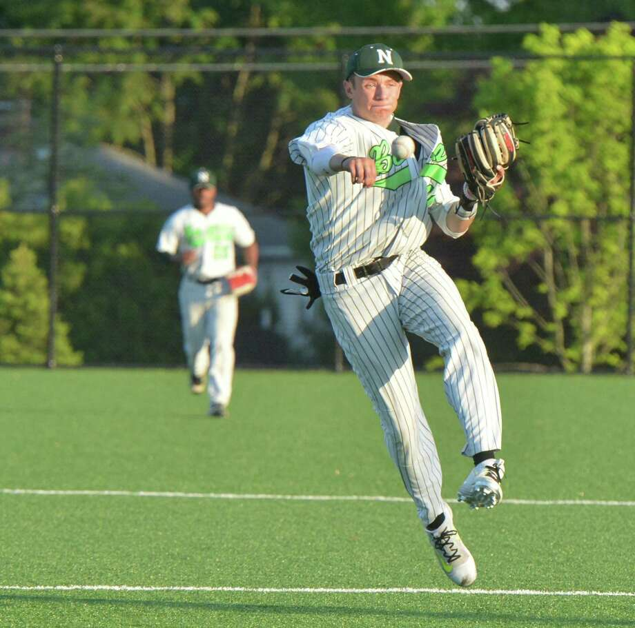 Norwalk's Eddie McCabe makes the catch and the throw during Wednesday's game against Darien. Photo: Alex Von Kleydorff / Hearst Connecticut Media / Norwalk Hour
