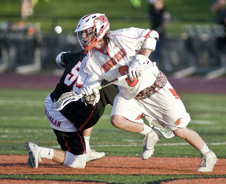 Ridgefield High School's Christopher Costello gets the draw in a game against New Canaan High School, played at Ridgefield. Wednesday, May 17, 2017 Photo: Scott Mullin / For Hearst Connecticut Media / The News-Times Freelance