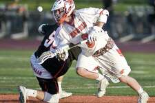 Ridgefield High School's Christopher Costello gets the draw in a game against New Canaan High School, played at Ridgefield. Wednesday, May 17, 2017