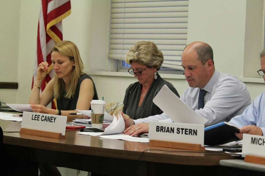 Sheri Gordon, Jen Tooker and Lee Caney, members of the finance board, examine the town's mill rate at their May 18, 2017 meeting in Westport Town Hall. Photo: Chris Marquette / Hearst Connecticut Media / Westport News