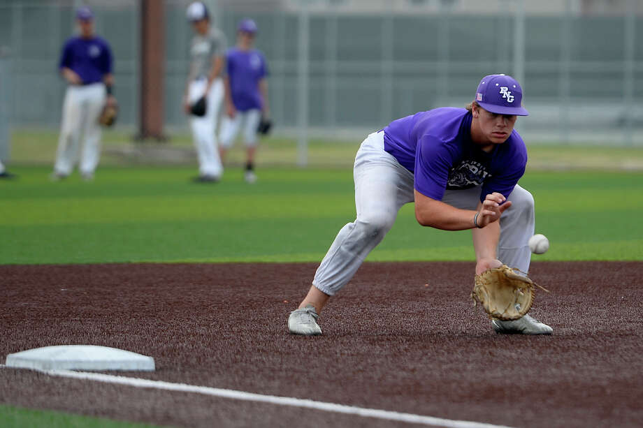 Port Neches-Groves third baseman Austin Bost fields a ground ball during baseball practice on Wednesday.  Photo taken Wednesday 5/17/17 Ryan Pelham/The Enterprise Photo: Ryan Pelham / ©2017 The Beaumont Enterprise/Ryan Pelham