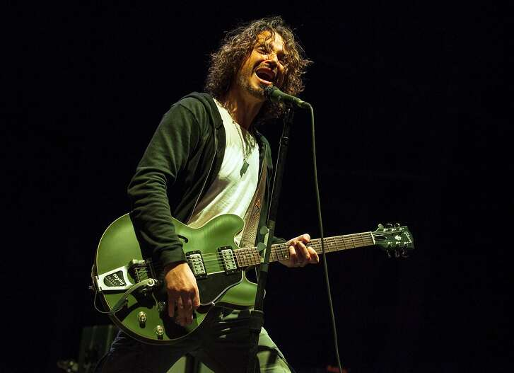 FILE - In this May 19, 2013 file photo, Chris Cornell of Soundgarden performs at Rock on the Range in Columbus, Ohio. Cornell, 52, who gained fame as the lead singer of the bands Soundgarden and Audioslave, died at a hotel in Detroit and police said Thursday, May 18, 2017, that his death is being investigated as a possible suicide. (Photo by Barry Brecheisen/Invision/AP, File)