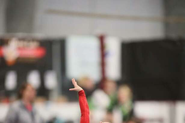 Darien Level 3 gymnast Penelope Hahn hit a dramatic pose to end her floor routine at the YMCA Northeast Regional Championships in Maine.