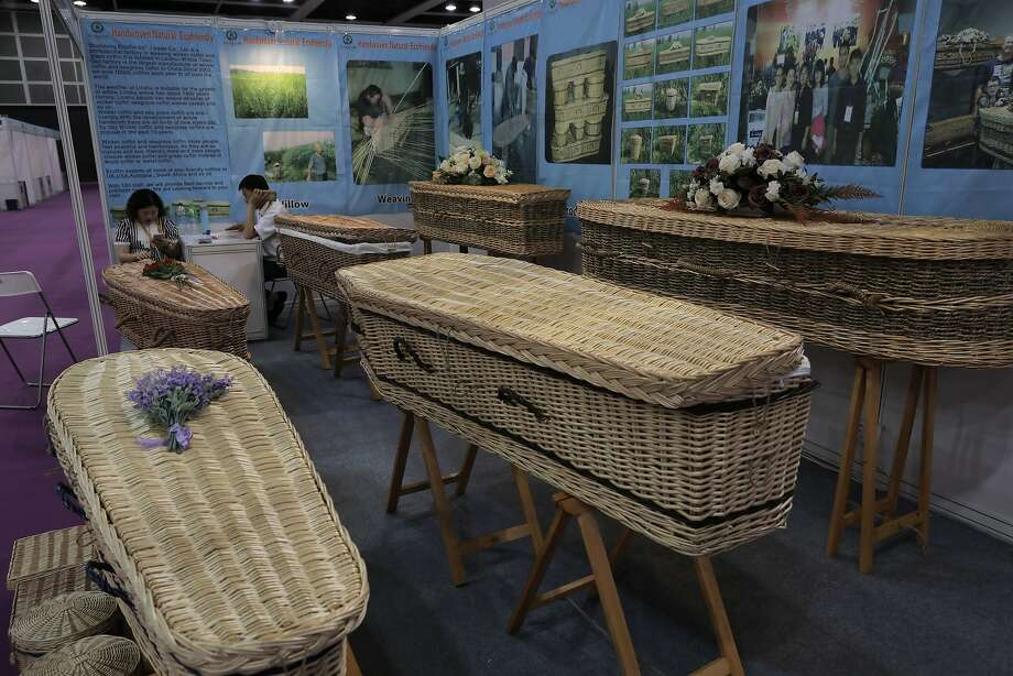 """Wicker and seagrass coffins highlight a trend toward """"green burials"""" in a booming industry. Photo: Vincent Yu, Associated Press"""