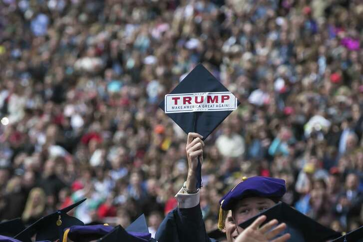 A student holds up a graduation cap with a Donald Trump sticker, while the president gave the commencement speech, at Liberty University in Lynchburg, Va. on May 13. In the speech, Trump spoke to the resentments and grievances of evangelicals.