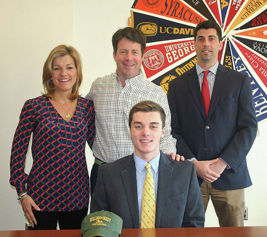 Fairfield Prep senior Jake Kealy, front, a resident of Wilton, is pictured with parents Annamarie and John, and Prep AD Tom Curran. Photo: Contributed Photo / Norwalk Hour