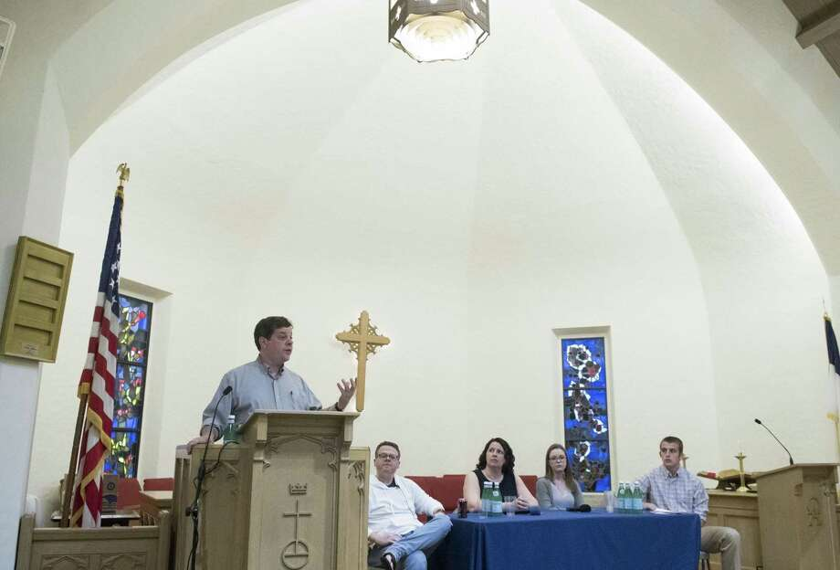 "A panel convenes to discuss suicide and other themes rising out of the Netflix series ""Thirteen Reasons Why"" at Second Congregational Church in Greenwich, Conn., May 17, 2017. Senior Minister at Second Congregational Church Reverend Maxwell Grant, left, moderated the event with panelists including, seated from left, Second Congregational Church Reverend Shawn Garan, Head of St. Luke's Upper School in New Canaan Liz Perry, and high school students Nicole Segal and Peyton Larkin. Photo: Keelin Daly / For Hearst Connecticut Media / Greenwich Time Freelance"