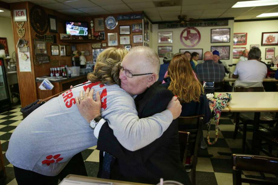 Wearing a Katy High School shirt, Jenifer Stockdick, left, a sixth generation Katy resident, hugged then-mayor Fabol Hughes, at Snappy's Cafe and Grill as the city of Katy prepared to send the team back to play for another title in the 6A, Division II state high school football in 2015. Hughes stepped down as mayor in May 2017. Photo: Michael Ciaglo, Houston Chronicle / © 2015  Houston Chronicle