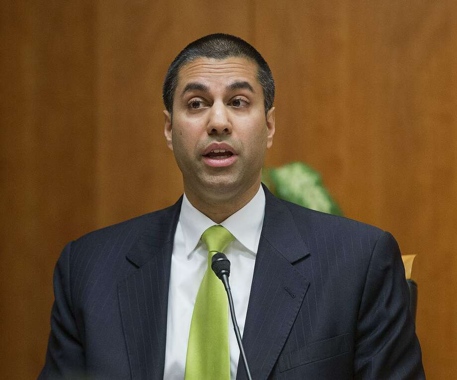 "FILE - In this Feb. 26, 2015, file photo, Federal Communication Commission Commissioner Ajit Pai speaks during an open hearing and vote on ""Net Neutrality"" in Washington. Dozens of internet companies are participating in an online protest on Wednesday in support of the Federal Communication Commission's seemingly doomed net-neutrality rules. Photo: Pablo Martinez Monsivais, Associated Press"
