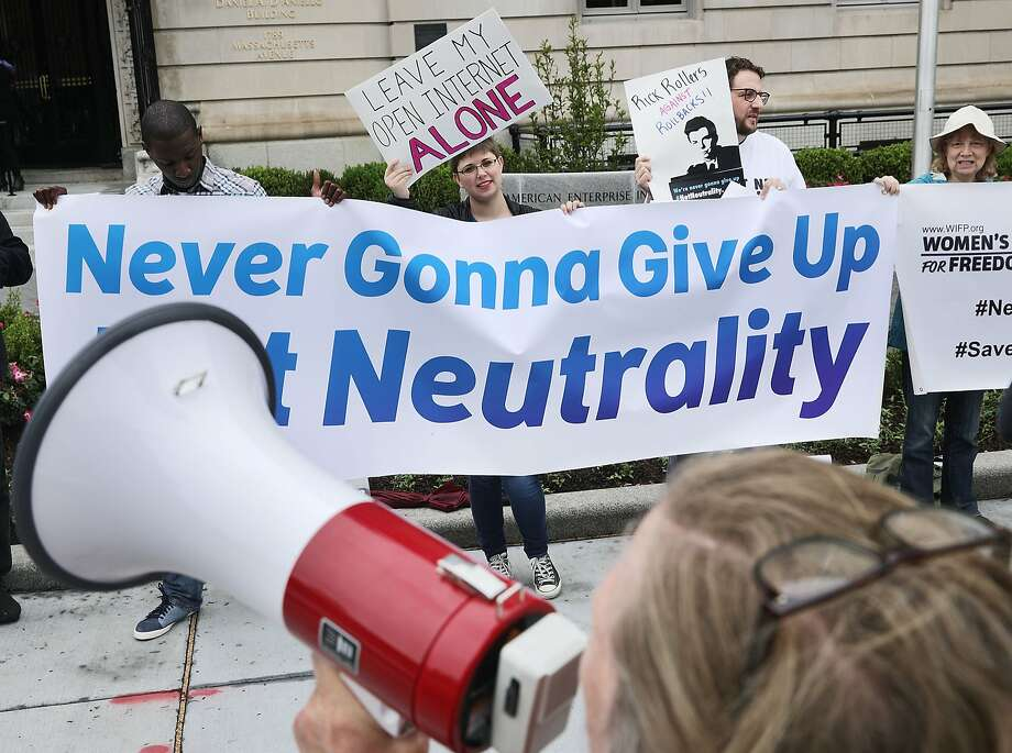 Proponents of net neutrality protest against Federal Communication Commission Chairman Ajit Pai outside the American Enterprise Institute before his arrival May 5 in Washington, D.C.  Photo: Chip Somodevilla, Getty Images