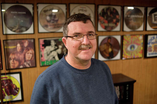 BRITTNEY LOHMILLER | blohmiller@mdn.net Bill Young of Midland poses for a portrait amongst his picture disc records Monday afternoon. Young is the administrator for the Michigan Record Club's Facebook page, which is a page for record collectors and enthusiasts. Young has approximately 2,400 records in his collection. 'I've always had records in my life,' Young said. 'But it wasn't until my second marriage that I started going to shops and collecting records.'