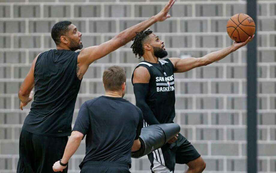 Patty Mills #8 of the San Antonio Spurs is guarded bu Tim Duncan during practice. Spurs practice at Spurs Practice facility on  Thursday, 5.18,2017 Photo: Ronald Cortes / Freelance