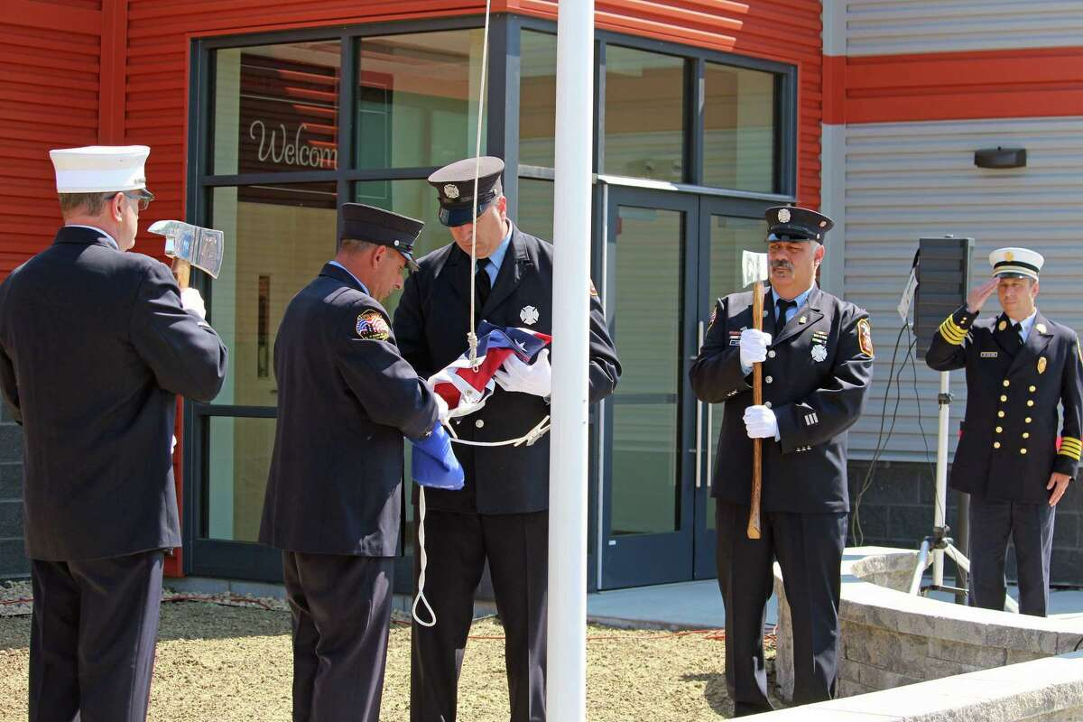 Flags are raised at the new fire regional fire training center on Richard White Way during ceremonies on Wednesday.