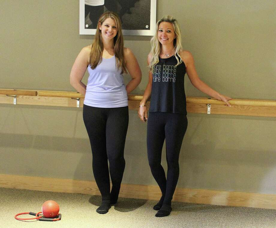 Melissa Buck, left, and Kristin McClutchy of Pure Barre in Darien, Pure Barre is offering free classes to nurses and teachers during May 2017. Photo: Erin Kayata / Hearst Connecticut Media / Darien News