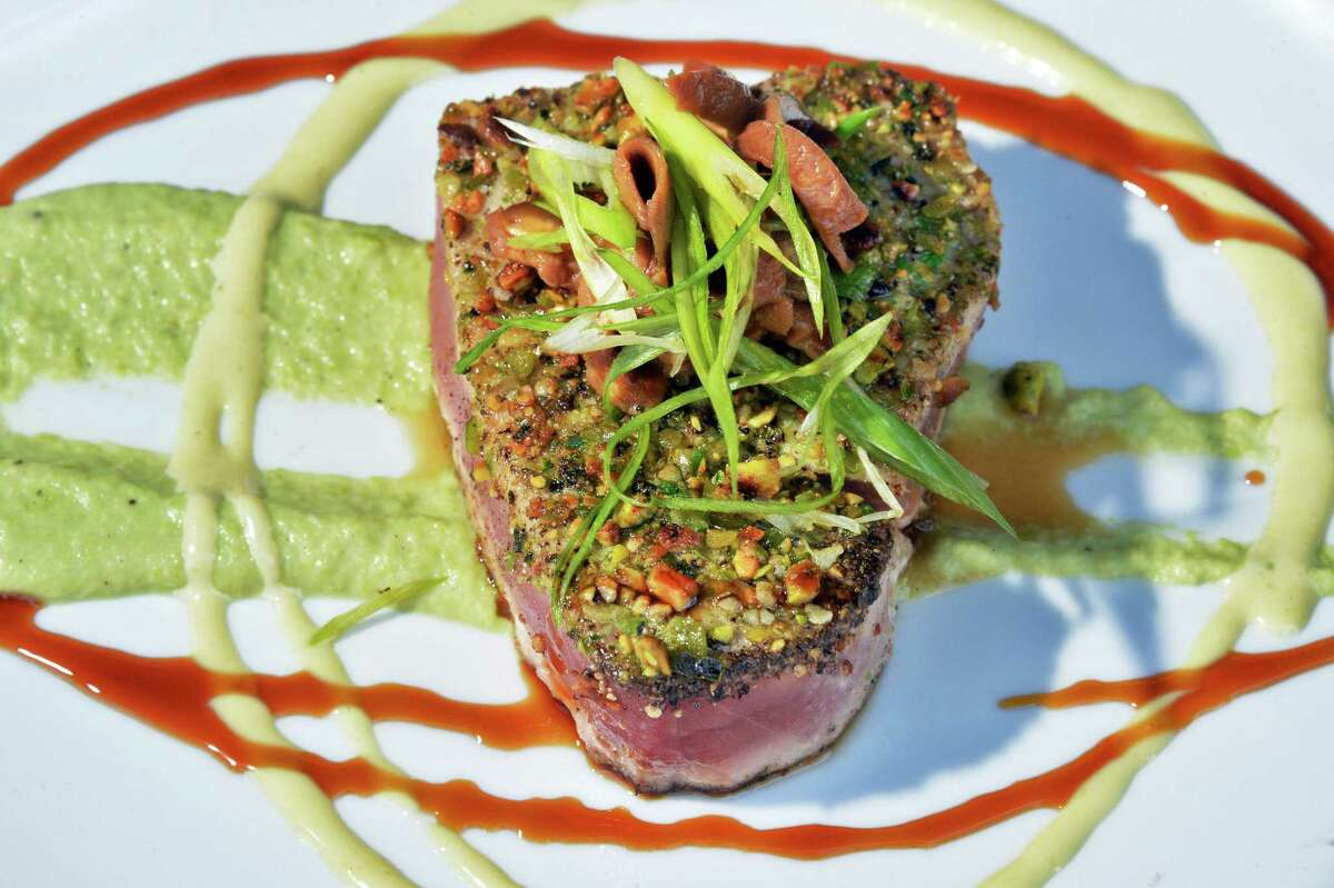 Seared Ahi with a pistachio wasabi pea crust at Fish at 30 Lake restaurant Thursday July 21, 2016 in Saratoga Springs, NY. (John Carl D'Annibale / Times Union)