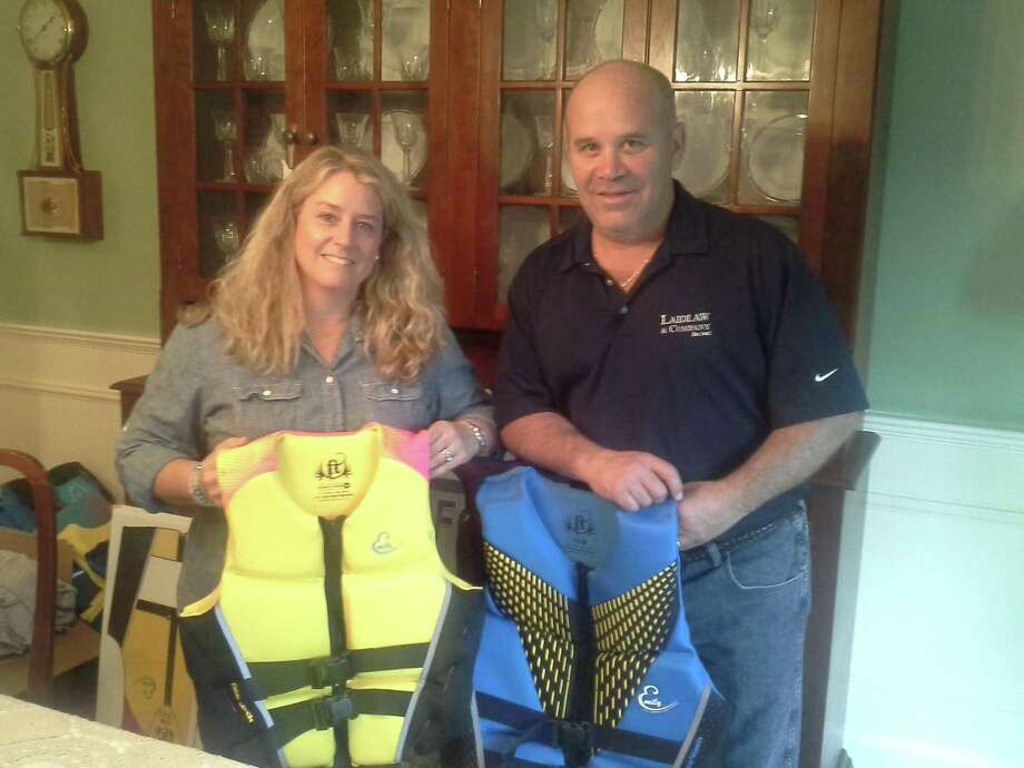 Pamela and Joe Fedorko show off life vests which will be given out to participants in Sunday s Emsway Walk for Boating Safety at Greenwich Point. Photo: Ken Borsuk /