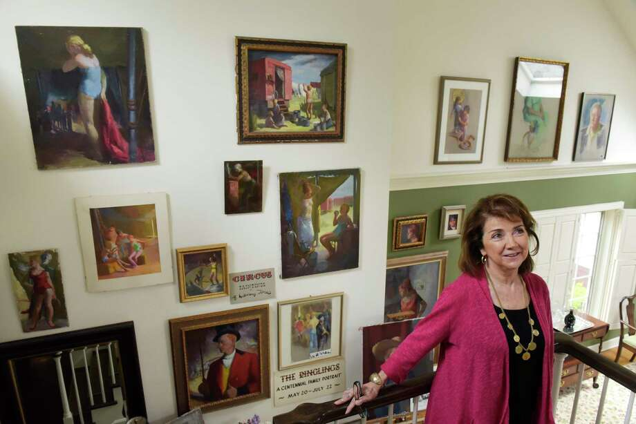 Diane Reilly poses with some of the artwork of artist Betty Warren at Reilly's home on Tuesday, May 9, 2017, in Voorheesville, N.Y.  From 1951 to 1958 Warren painted scenes from the back lot of Ringling Bros. circus.   (Paul Buckowski / Times Union) Photo: PAUL BUCKOWSKI / 20040429A