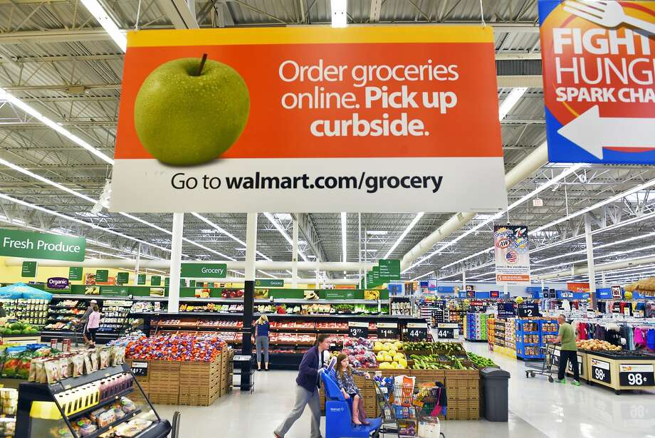 In-store signage announces the start of new online grocery pick up service at Walmart Stores Tuesday May 2, 2017 in Halfmoon, NY.  (John Carl D'Annibale / Times Union) Photo: John Carl D'Annibale, Albany Times Union