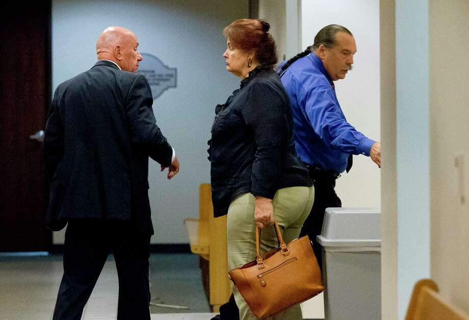 Herman Hoffman, right, is seen beside her his wife Kathleen, center, and their lawyer Bill Power during a court recess as the jury deliberates whether or not to convict the couple with five Class A misdemeanors of cruelty to non-livestock animals each in Judge Dennis Watson's County Court-at-Law 1, Thursday, May 18, 2017, in Conroe. Photo: Jason Fochtman, Staff Photographer / © 2017 Houston Chronicle