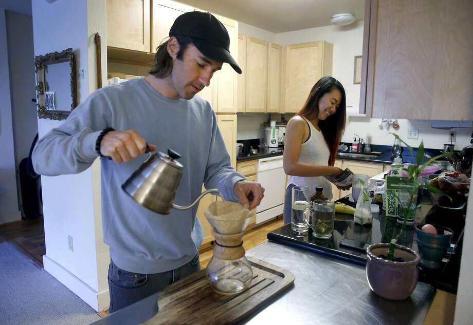 Jered Snyder and his wife Jen Zhao make breakfast in their apartment in Oakland, Calif. on Thursday, May 18, 2017. Snyder and Zhao, who married in 2015, are among a growing trend of interracial couples. Photo: Paul Chinn, The Chronicle