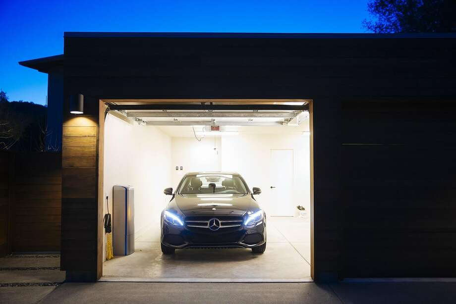 The Mercedes-Benz energy-storage battery (left), about the size of a mini-fridge, allows homeowners to store energy from solar power systems. Photo: VIVINT SOLAR, NYT