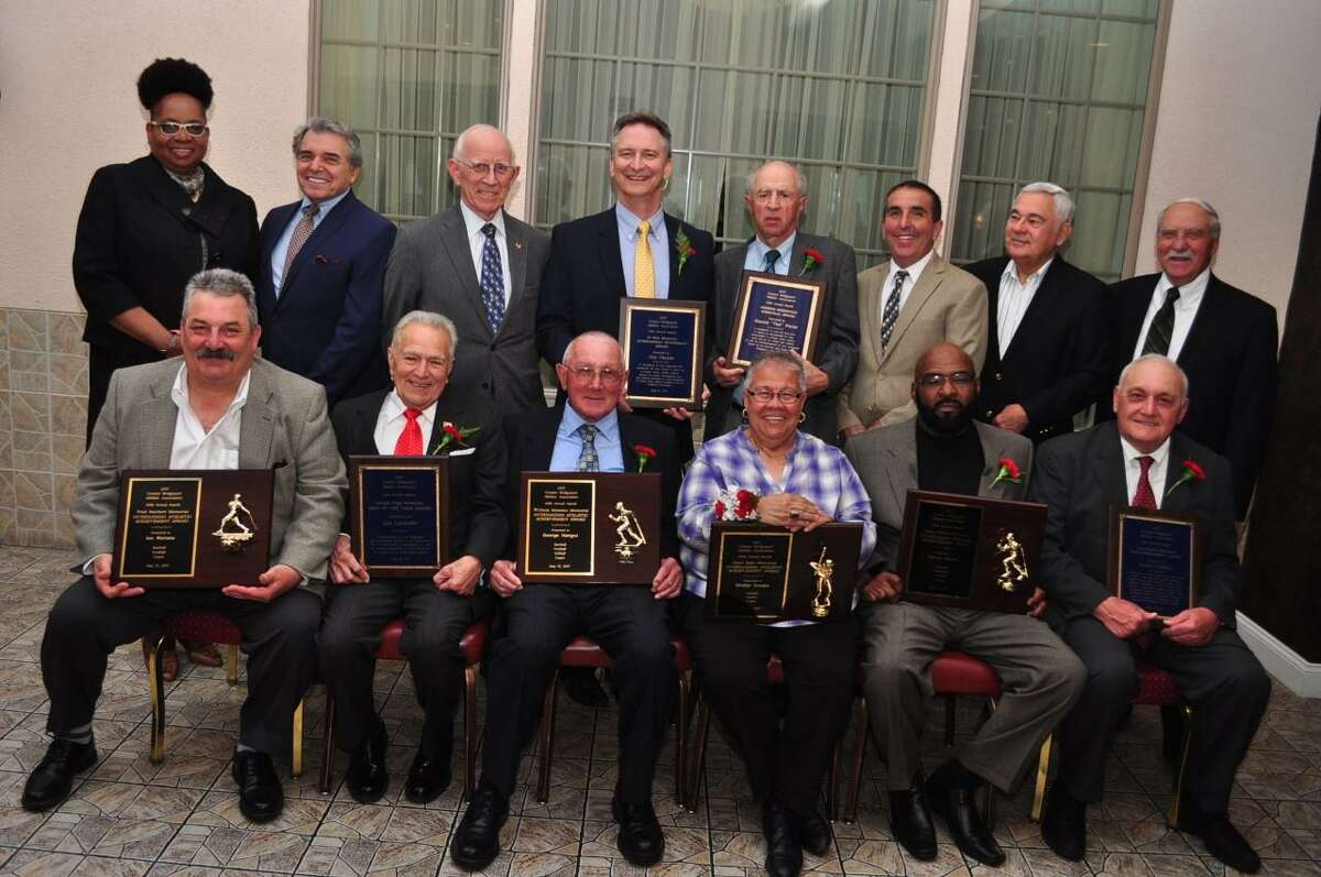 The Greater Bridgeport Athletic Association (Old Timers) conducted its 60th annual awards banquet recently at Testo's. Front row, from left: Joe Rietano, Joe Leonetti (Man of the Year), George Hangos, Gladys Crespo, Ken Spears and Rudy Costello (Past Presidents Award). Back row: Faith Gospel Assembly Pastor Brenda Barnes; Board of Directors chairman Joe Giaquinto; President Tom Kanasky; Jim Olayos (Outstanding Sportsman); Ted Parisi (George Sherwood Award); Stratford Old Timers President Neil Dinihanian; author and baseball historian Rich Marazzi and emcee John Giampaolo. Rietano, Hangos, Crespo and Spears received Outstanding Athletic Achievements awards.