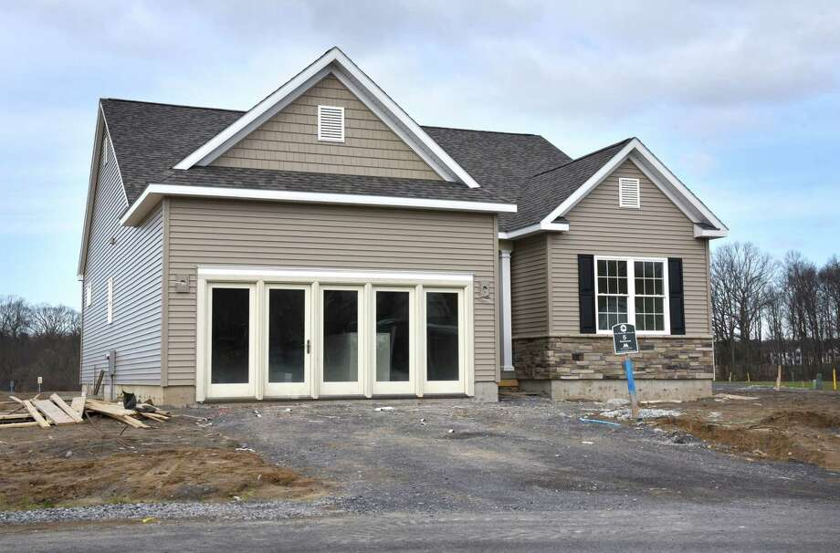 The model home at Newell Place housing development off Wemple Road on Thursday, April 13, 2017, in Bethlehem, N.Y. There are 40 lots in the development and customers will have 12 home styles to choose from. (Will Waldron/Times Union) Photo: Will Waldron / 20040215A
