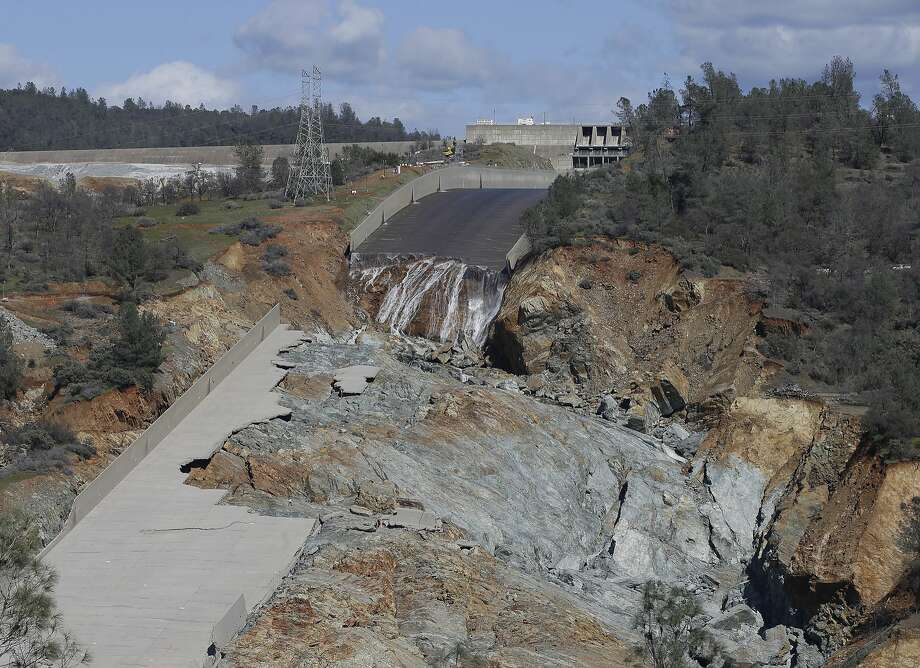 In this Feb. 28 file photo, a small flow of water drops down Oroville Dam's crippled main spillway. Photo: Rich Pedroncelli, Associated Press