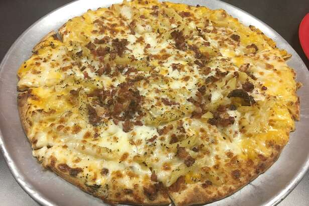 a macaroni and cheese pizza with bacon added from Firehouse Pizza in Peoria.