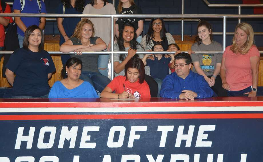 Plainview High School senior Fatima Diaz, seated center, signs a letter of intent Thursday to play volleyball at Bacone College in Muskogee, Okla. Looking on, from left, are Plainview assistant volleyball coach Amanda Martin, Fatima's mom Maria Diaz, Fatima's dad Jose Diaz, and Plainview volleyball head coach Torri Hatch. Friends and teammates look on in the background. Photo: Skip Leon/Plainview Herald