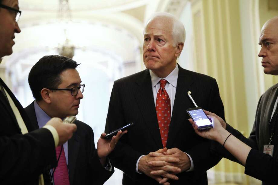 Senate Majority Whip John Cornyn of Texas talks May 10 with reporters on Capitol Hill in Washington. Cornyn has taken himself out of the running to be FBI director, telling the Trump administration that hell stay in the Senate. Photo: Jacquelyn Martin /Associated Press / Copyright 2017 The Associated Press. All rights reserved.