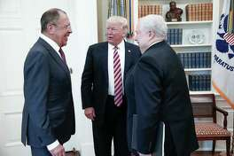 In this photo from the Russian Foreign Ministry, President Donald Trump speaks with Russian Foreign Minister Sergei Lavrov (left) and Russian Ambassador Sergei Kislyak at the White House. During the meeting, Trump exhibited what a reader terms odd behavior.