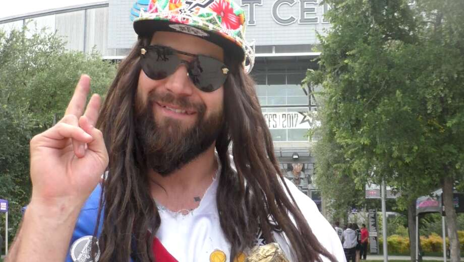 Spurs Jesus throws a peace sign, posing outside of the AT&T Center. Photo: By Lindsey Gawlik