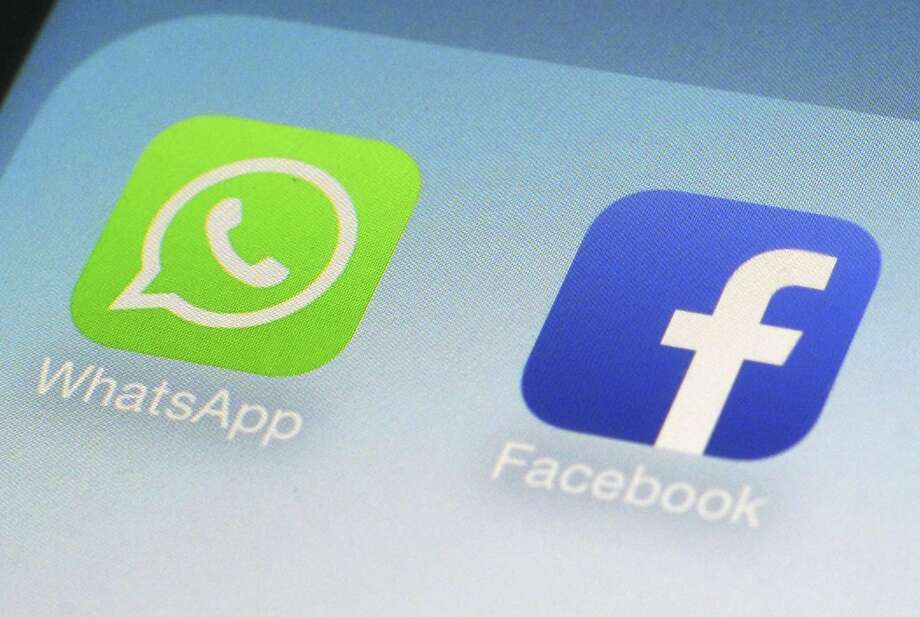 This Feb. 19, 2014, file photo, shows WhatsApp and Facebook app icons on a smartphone in New York. Photo: Patrick Sison, Associated Press