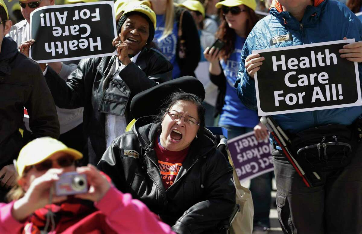 Protesters march on the Texas capitol in 2013. They were demanding that lawmakers expand Medicaid to include an additional 1.5 million poor people. (AP Photo/Eric Gay)