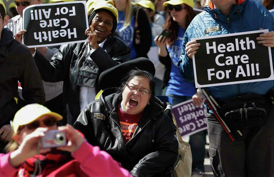 Protesters march on the Texas capitol in 2013. They were demanding that lawmakers expand Medicaid to include an additional 1.5 million poor people. (AP Photo/Eric Gay) Photo: Eric Gay, Associated Press / AP