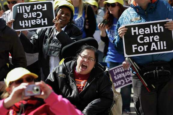 Protesters march on the Texas capitol, Tuesday, March 5, 2013, in Austin, Texas. Protesters demanded that lawmakers expand Medicaid to include an additional 1.5 million poor people. (AP Photo/Eric Gay)