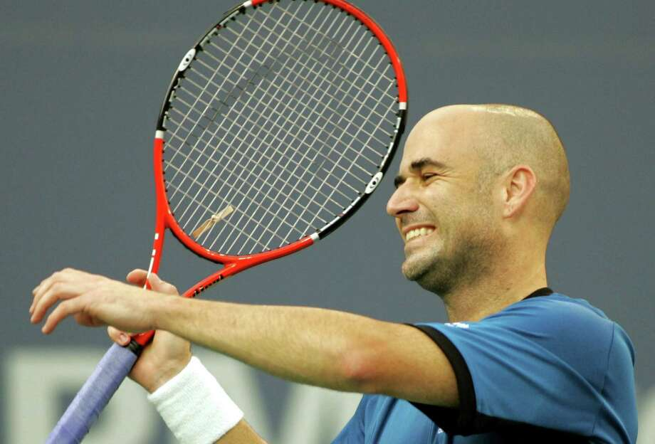 Andre Agassi reacts during his match against Roger Federer during the men's final at the U.S. Open in New York, on Sept. 11, 2005. Photo: Associated Press File Photo / REUTERS POOL