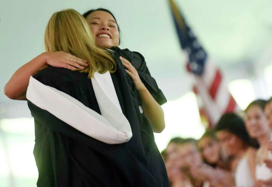 New graduate Rachel Windreich hugs Head of School Molly King after receiving her diploma at Greenwich Academy's 190th Commencement at the Greenwich Academy campus in Greenwich, Conn. Thursday, May 18, 2017. Deirdre Daly, the first woman to hold the post of U.S. Attorney for the State of Connecticut, delivered the graduation address before 87 new graduates walked across the stage. Photo: Tyler Sizemore, Hearst Connecticut Media / Greenwich Time