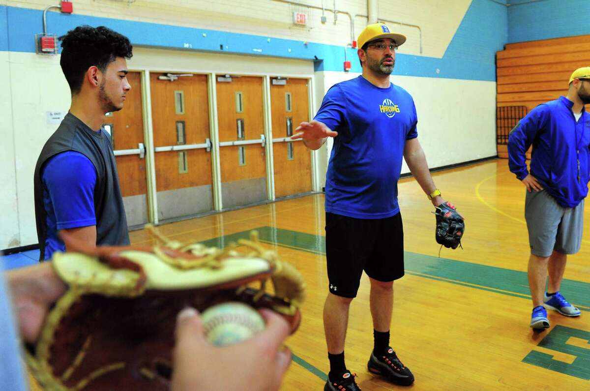 Harding baseball coach Gary Diaz works with his team as they practice in the school's gym this week in Bridgeport. The Presidents qualified for the state tournament for first time since 1988.